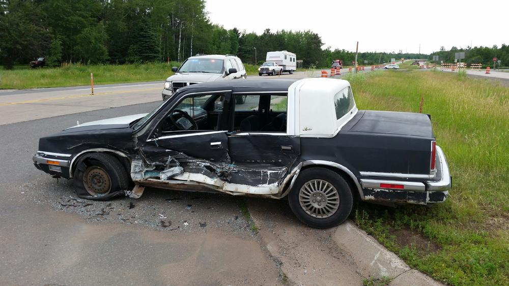 side-view of vehicle with driver's side smashed in from accident
